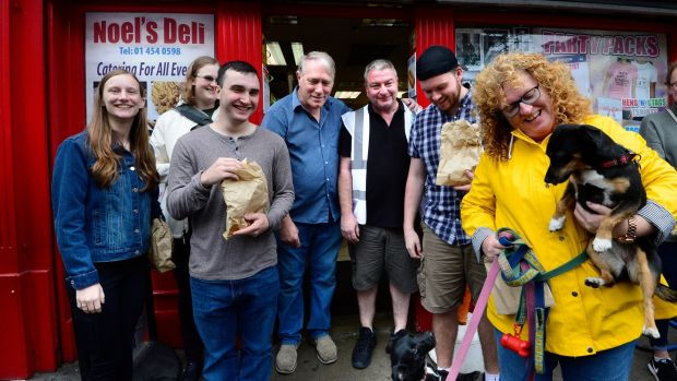 American students Stephanie Hauer, Steven Baumann, Anais Mohr, and Jacob White on Meath Street with local shopkeeper Noel Fleming, cultural officer for the Liberties James Madigan and local shopper Emer Sweeney and her dog. Photograph: Cyril Byrne