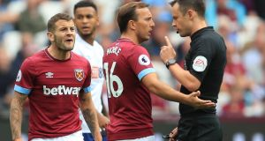 Jack Wilshere and Mark Noble of West Ham  argue with referee Stuart Attwell during their Premier League match against  Bournemouth at London Stadium last Saturday. Photograph: Marc Atkins/Getty Images