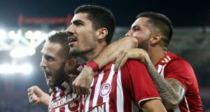 Kostas Fortounis, Andreas Bouchalakis and Miguel Angel Guerrero of Olympiakos celebrate  Andreas Bouchalakis's goal  during the Uefa Europa League playoff first leg  match against Burnley at  Karaiskaki Stadium in Piraeus, Greece. Photograph: Georgia Panagopoulou/EPA