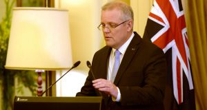 "Australian prime minister Scott Morrison after being sworn in at Government House in Canberra. ""We are on your side,"" he said. Photograph:  Martin Ollman/Getty Images"
