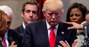 Michael Cohen, behind Donald Trump on the left, at a campaign stop at the New Spirit Revival Center in Cleveland, Ohio, on September 21st, 2016. Photograph: Eric Thayer/New York Times