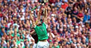 Galway's Cathal Mannion and Dan Morrissey of Limerick in action during the All-Ireland final. Photograph: Ryan Byrne/Inpho