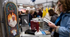 Memorabilia featuring the image of Pope Francis on sale at the Meeting of Families Pastoral Congress in Dublin. Photograph: Will Oliver/EPA