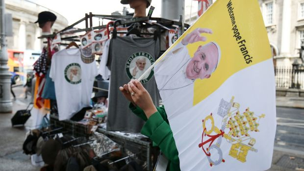 T-Shirts and flags of Pope Francis on sale in Dublin, ahead of this weekend's visit by Pope Francis. Photograph: Aaron Chown/PA Wire