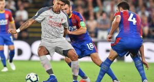 Liverpool's Roberto Firmino in action against  Crystal Palace   midfielder James McArthur during the Premier League clash at Selhurst Park.   GlynKirk/AFP