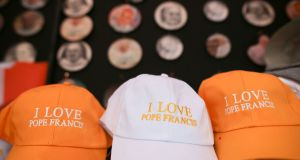 'I Love Pope Francis' hats on sale in Dublin, ahead of this weekend's visit to Ireland by Pope Francis. Photograph: Aaron Chown/PA Wire