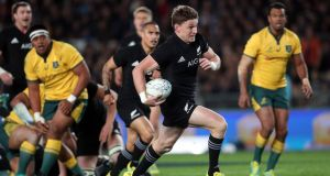 New Zealand outhalf Beauden Barrett runs away from the Australia defence ato score one of his four tries during the Rugby Championship match at Eden Park in Auckland . Photograph: Michael Bradley/AFP/Getty Images