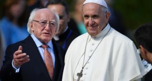Pope Francis is welcomed by President Michael D Higgins during his visit in Dublin. Photograph: Dylan Martinez/Reuters