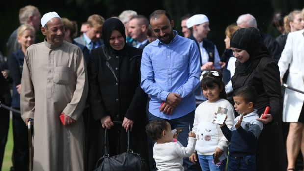 The Hassoun family including Saif Eddin Hassoun, Sana Edris, Mohmoud Al A'Araj, Hasba Hassoun, Lana Al A'Araj (6), Aala Al A'Araj, (4) and Tala Al A'Araj (1), wait to meet Pope Francis following a tree planting ceremony at Áras an Uachtaráin. Photograph: Joe Giddens/PA