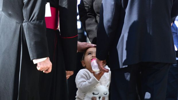 Pope Francis touching the head of Tala Al A'Araj (1) from Syria during his visit to Áras an Uachtaráin. Photograph: Cyril Byrne/The Irish Times