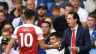 Mesut Ozil with Unai Emery after coming off in the defeat to Chelsea. Photograph: Mike Hewitt/Getty Images