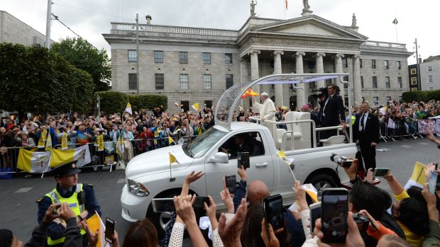 Pope Francis passes through O'Connell Street, Dublin, in the popemobile. Photograph: Dara Mac Dónaill/The Irish Times