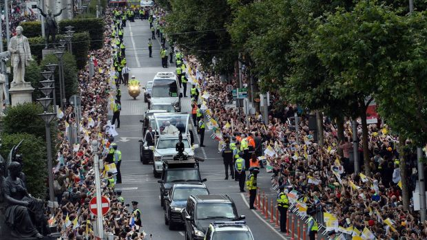 Pope Francis travelling through Dublin's O'Connell Street. Photograph: Cyril Byrne/The Irish Times