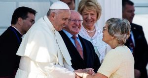 Pope Francis shakes hands with Katherine Zappone, Minister  for Children and Youth Affairs, at a reception at Áras an Uachtaráin  in Dublin. Photograph: Will Oliver/EPA