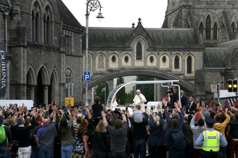 Pope Francis waves to the waiting crowds at Christ Church, Dublin. Photograph: Brian Lawless/PA Wire