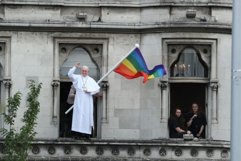 A rainbow flag is flown next to a likeness of Pope Francis as crowds wait for the pope to pass by in the popemobile during his visit to Dublin. Photograph: Danny Lawson/PA Wire
