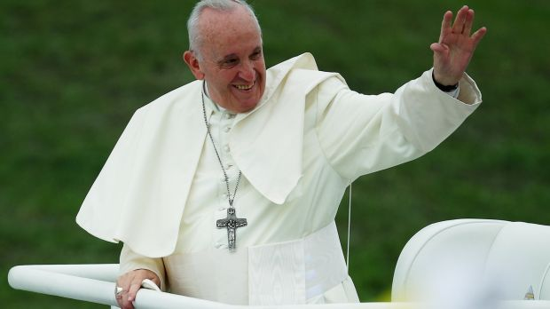 Pope Francis waves as he arrives at the World Meeting of Families closing mass in Phoenix Park. Photograph: Hannah McKay/Reuters