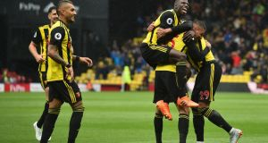 Watford's German-born Greek midfielder celebrates scoring. Photograph: Jose Holebas/Getty Images