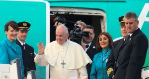Pope Francis waves from the steps of his Aer Lingus jet  during a farewell ceremony upon his departure at Dublin Airport in Dublin on Sunday evening. Photograph: Paul Faith/AFP/Getty Images