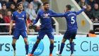 Chelsea's Marcos Alonso, Olivier Giroud and Jorginho celebrate after Newcastle United's DeAndre Yedlin scores an own goal. Photograph: Reuters