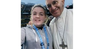 Alison Nevin as she managed to get a selfie on stage with Pope Francis on Saturday night at Croke Park in Dublin, during the Festival of Families event, as part of his visit to Ireland. Photograph: PA Wire