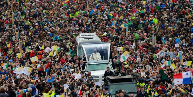 Pope Francis in the popemobile moving through the crowds in the Phoenix Park. Photograph: Nick Bradshaw/The Irish Times