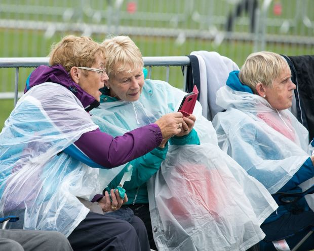 A scene from the Phoenix Park in advance of the Pope's arrival. Pictured are Irene O'Brien, Mary Murphy and Jean Kennelly from Swords. Photograph: Dave Meehan/The Irish Times