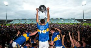 Tipperary's Colin English lifts the trophy at the Gaelic Grounds. Photograph: Tommy Dickson/Inpho