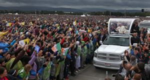 Different times: Pope Francis arrives at the Phoenix Park for Mass on Sunday. Photograph:  Colin Keegan, Collins Dublin