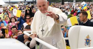 Pope Francis waves to the faithful as he arrives to lead the Holy Mass at Phoenix Park on Sunday.  Photograph: Ben Stansall/AFP/Getty Images