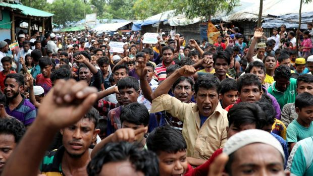 Rohingya refugees take part in a protest at the Kutupalong refugee camp to mark the one-year anniversary of their exodus in Cox's Bazar, Bangladesh on Saturday. Photograph: Mohammad Ponir Hossain/Reuters