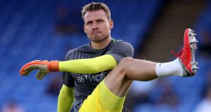 Liverpool goalkeeper Simon Mignolet warms up before the Premier League match against Crystal Palace at Selhurst Park. Photo: Nick Potts/PA Wire