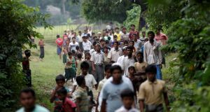Men walk at a Rohingya village outside Maungdaw in Rakhine state, Myanmar in October 2016. Facebook posts have stirred up and spread hatred against the minority Rohingya population in Myanmar. Photograph: Soe Zeya Tun/Reuters