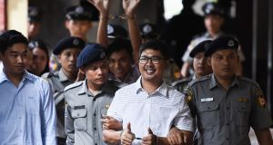 Reuters journalist Wa Lone  followed by Kyaw Soe Oo: the two reporters have pleaded not guilty to violating Myanmar's colonial-era Official Secrets Act, which carries a penalty of up to 14 years.  Photograph:  Ye Aung Thu/ AFP/Getty Images