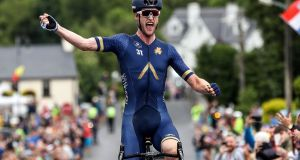 Team Aqua Blue's Conor Dunne celebrates winning the National Road Racing Championships. Photo: Bryan Keane/Inpho