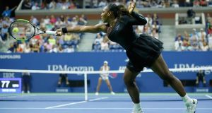 Serena Williams hits a return to Magda Linette during their 2018 US Open women's singles match. Photo Eduardo Munoz Alvarez/Getty Images