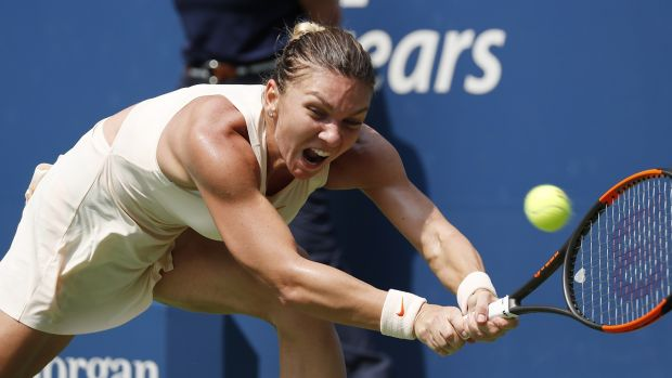 Halep hits a return during her loss to Kaia Kanepi. Photo: John G Mabanglo/EPA