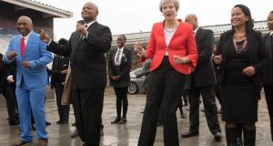 British Prime Minister Theresa May dancing with students  in Cape Town. Photograph: Stefan Rousseau/PA