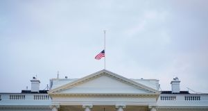 The US flag above the White House flies at half-staff in the evening in Washington, DC, on August 27, 2018. - Under fire for what critics said was a lack of respect for the late US senator John McCain, President Donald Trump issued a formal proclamation about the lawmaker's death and ordered the White House flag back to half-staff. The proclamation affects the flag atop the White House and all public buildings, as well as military installations and embassies. MANDEL NGAN/AFP/Getty Images