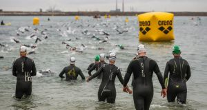 Competitors enter Scotsman's Bay in Dún Laoghaire during the Ironman 70.3. Photo: Ryan Byrne/Inpho