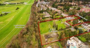 A newly-registered company has lodged a planning application to build 14 houses and 38 apartments at the rear of three properties backing on to Leopardstown racecourse.