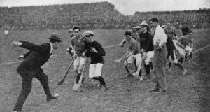 Michael Collins throwing in the ball to start a hurling match at Croke Park, Dublin in 1921. Photograph: Hogan/ Hulton Archive/ Getty Images
