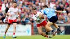 Niall Sludden tries to elude the clutches of Dublin's Eoin Murchan during the All-Ireland Super 8s clash  in Omagh. Photograph: James Crombie/Inpho