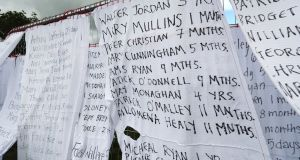 Bed sheets with the names of hundreds of dead children draped on the gates of a mass burial site at Tuam, Co Galway.  Photograph:  Niall Carson/PA Wire