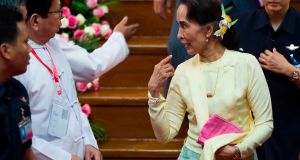 Myanmar's Aung San Suu Kyi after addressing students at  Yangon University: said nothing  on content of  report on genocide. Photograph: Ye Aung Thu/AFP/Getty