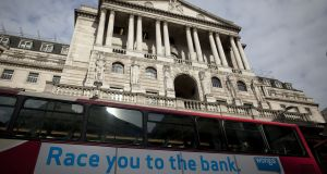 Wonga.com ad on a bus passing the Bank of England in London: firm piled fees and penalties on stressed customers. Photograph: Simon Dawson/Bloomberg