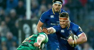Leinster's Sean O'Brien in action against Treviso Benetton's  Simone Ferrari. Photograph: James Crombie/Inpho