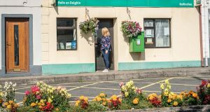 Ann Gilmore closes the door for on the last day of business at the Post Office in Ballindine, Co Mayo. Photograph: Keith Heneghan