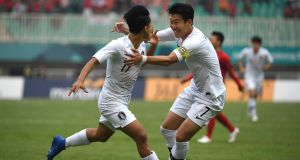 South Korea's Lee Seung-woo celebrates with Son Heung-min after scoring during their Asian Games semi-final against Vietnam. Photo: Arief Bagus / AFP)ARIEF BAGUS/AFP/Getty Image