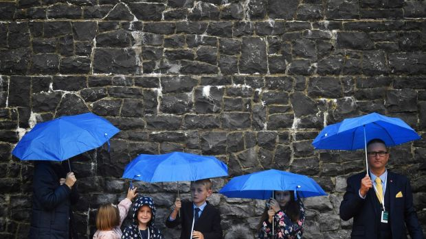 Children wait amid the rain ahead of a visit by Pope Francis to Knock Shrine in Co Mayo last weekend. Photograph: Dylan Martinez/Reuters